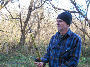 George inspects hiking pole