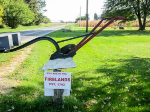 Firelands sign by a mailbox